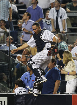 June 7: Red Sox 6, Yankees 4 Catcher Russell Martin went to great lengths in an attempt to catch a foul ball, but was unable to make the grab.