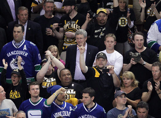 Canadian Prime Minister Stephen Harper (center) attended Game 4 at TD Garden.