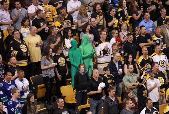 Bruins fans and the Vancouver Green Men stood for the national anthem.