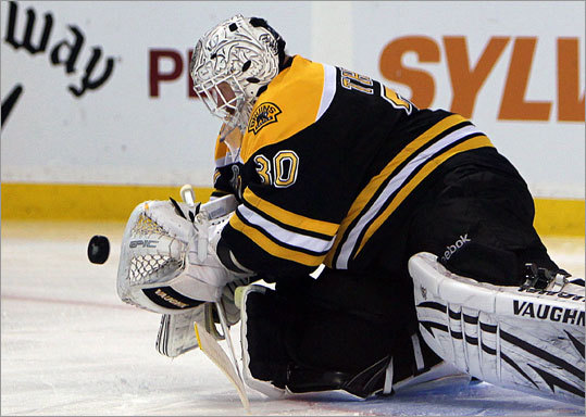 Bruins goalie Tim Thomas made one of his saves in the second period.