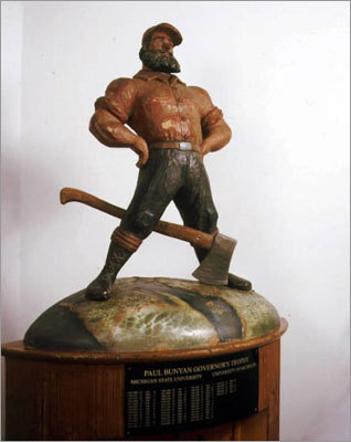 College football: Rivalry trophies Many of the annual college football rivalry games feature unique prizes such as the Paul Bunyan Trophy, awarded annually to the winner of the Michigan-Michigan State game and not to be confused with the Paul Bunyan Axe (Minnesota vs. Wisconsin). Others include the Fremont Cannon (Nevada vs. UNLV); the Stanford Axe (Cal-Berkeley vs. Stanford); the Old Oaken Bucket (Indiana vs. Purdue); the Apple Cup (Washington vs. Washington State); and the Wagon Wheel (Akron vs. Kent State).