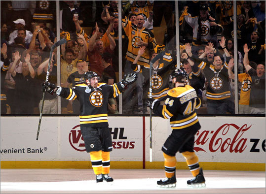 Brad Marchand (left) gave the Bruins a 3-0 lead in the third period of Game 4 of the Stanley Cup Final at TD Garden. Dennis Seidenberg (right) and the Garden fans were pleased with the turn of events.
