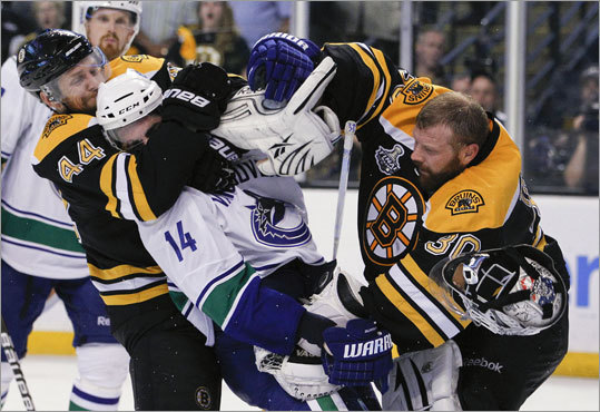 Bruins goalie Tim Thomas wasn't allowing anything to invade his space, and that included Vancouver's Alex Burrows. Thomas and defenseman Dennis Seidenberg pushed Burrows and the Canucks around in a 4-0 victory in Game 4 of the Stanley Cup Final. The series is tied 2-2.