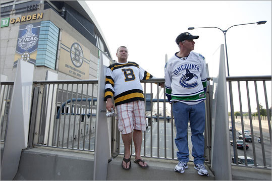 Rod Therres of Vancouver (right) and Ken Middleton of Ontario traveled together from Ontario, but to root for opposing teams. They said they are friends, but not during the game.
