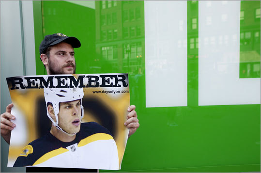 Robb Pizzuto of Waltham made a sign that referenced the events of Game 3, in which Bruins player Nathan Horton was knocked out of the series with a concussion suffered in a late by the Canucks' Aaron Rome. Rome was suspended four games.