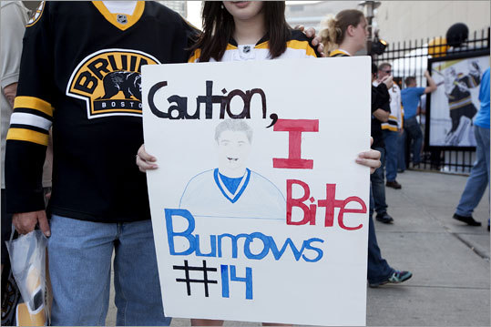 Frank and Alyssa Maine of Templeton held a sign made by Alyssa that mocked Canucks player Alex Burrows, who bit Bruins player Patrice Bergeron in Game 1.