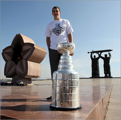 Back to the motherland The most common thing for a player to do beside kiss the Cup is take the trophy to his hometown. For Penguins center Evgeni Malkin, that meant a trip to Magnitogorsk, Russia, where he was photographed with it near a World War II monument.
