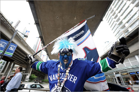 Canucks fan Andrew Nicholson posed outside the arena.