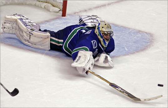 Canucks goalie Roberto Lungo stretched to poke the puck away in the second period.