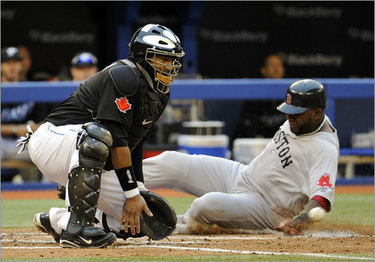 June 11: Red Sox 16, Blue Jays 4 Red Sox designated hitter David Ortiz scored ahead of the throw to Blue Jays catcher Jose Molina in the third inning. Ortiz scored on a single to center by Marco Scutaro.
