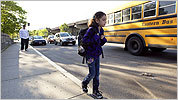 With her father, Alex, watching, Aryana Saavedra headed to a bus that takes her to school in Wellesley