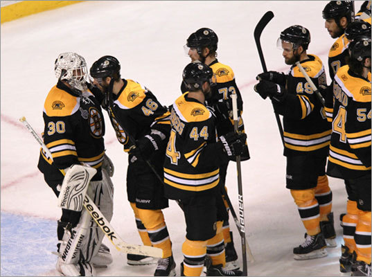 Bruins players celebrated with goaltender Tim Thomas (left), who made 36 saves in a 5-2 win over the Vancouver Canucks in Game 6 of the Stanley Cup Final Monday night at TD Garden.