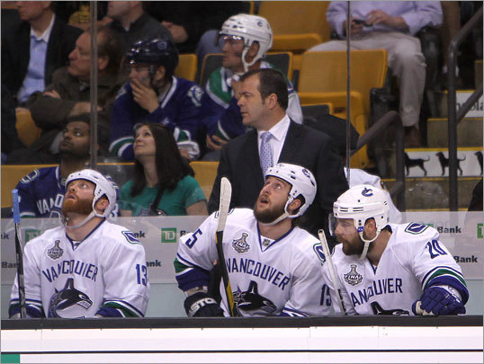 The Canucks bench could only watch as time ticked down late in the third period.