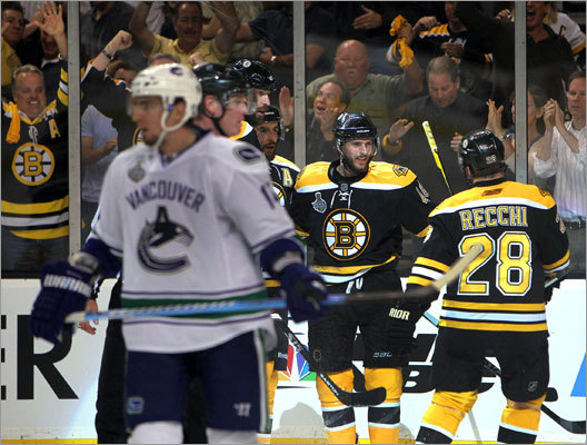Vancouver's Alexandre Burrows skated away as the Bruins celebrated a goal by David Krejci that put the Bruins up 5-1 in the third period.