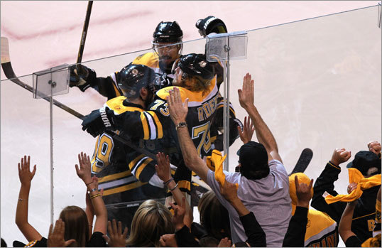 The Bruins weren't done scoring in the first period, ad Michael Ryder (center) scored to give them a 4-0 lead. The Bruins scored four goals in a 4:14 span in the first period, setting a Stanley Cup Final record.