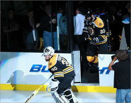 Goalie Tim Thomas and defenseman Zdeno Chara led the Bruins onto the ice for Game 6.