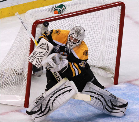 Bruins goalie Tim Thomas kept the Canucks off the board in the first period with an array of dazzling saves. He made 12 saves in the first period of Game 6 at TD Garden.