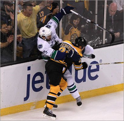 Bruins defenseman Andrew Ference (front) put a heavy hit on Canucks center Ryan Kesler in the first period.