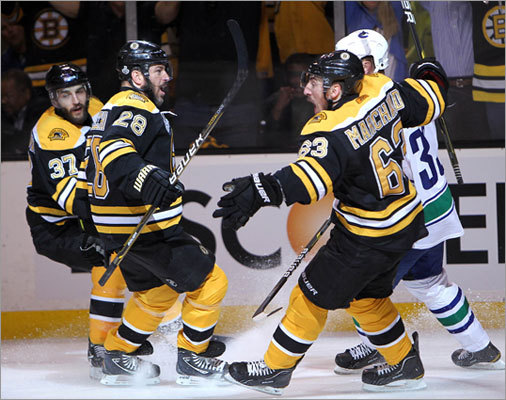 Brad Marchand (right) celebrated his goal with teammates Patrice Bergeron (left) and Mark Recchi.