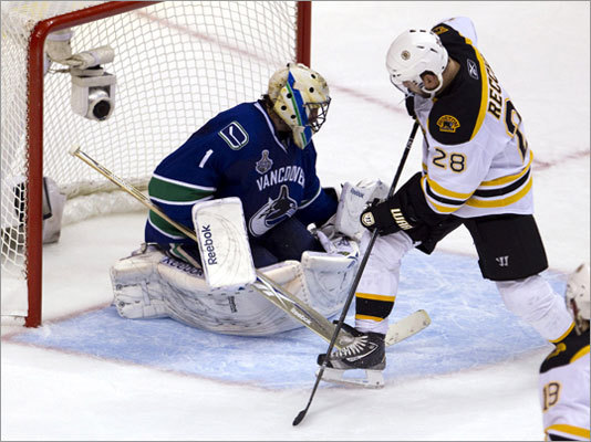Old-timer makes history Game 2: Canucks 3, Bruins 2 (OT) A 43-year-old had never scored in a Stanley Cup final prior to Mark Recchi's deflection in Game 2. With the Bruins leading for the first time in the series, defenseman Zdeno Chara fired a shot from the blue line and Recchi tipped the puck past Vancouver goalie Roberto Luongo. Before that goal, Igor Larionov was the oldest player to score in a Cup final. He did it at 41 in Game 4 of the 2002 finals for the Red Wings at Carolina.