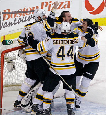 Bruins Zdeno Chara, Dennis Seidenberg, Brad Marchand and Tomas Kaberle mobbed goalie Tim Thomas just after the clock struck zero in the third period and the game, kicking off a furious celebration on the ice.