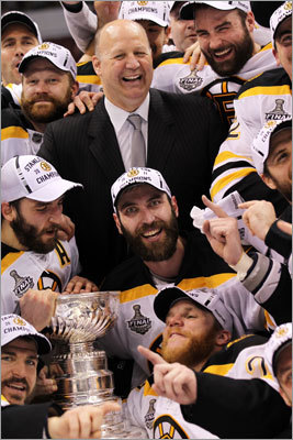 Head coach Claude Julien (top) and captain Zdeno Chara were at the center of the celebration during the team photo.