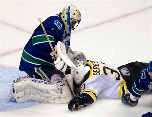 Bruins center Patrice Bergeron slid into Canucks goalie Roberto Luongo on his way to scoring during the second period.