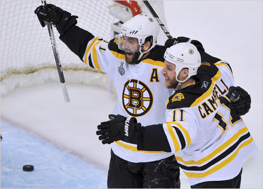 Bruins center Patrice Bergeron celebrated his second goal on the Canucks with teammate Gregory Campbell.
