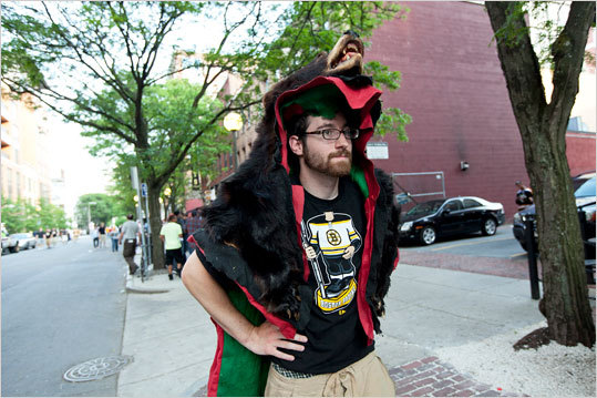 Kyle Heavey of Allenstown, N.H., wore the fur of a black bear while walking around near the TD Garden looking for a bar that has some space.