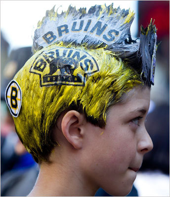 Max Ray, 10, of Bolton, Mass., showed his team colors as he arrived for Game 7 in Vancouver.