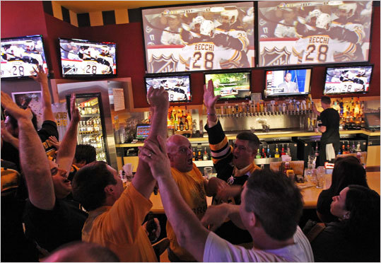 Clockwise from center, Adam Roberts, JJ Gallant, and Mike O'Neil celebrated Wednesday at Buffalo Wild Wings in Saugus, Mass.