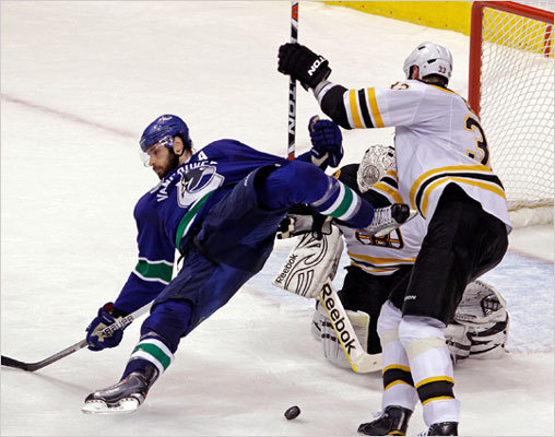 Bruins captain Zdeno Chara leveled Canucks center Ryan Kessler in front of the Bruins net in the second period.