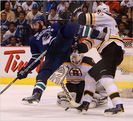 Bruins defenseman Zdeno Chara drew a cross-checking penalty with this hit of Canucks center Ryan Kesler during the second period.