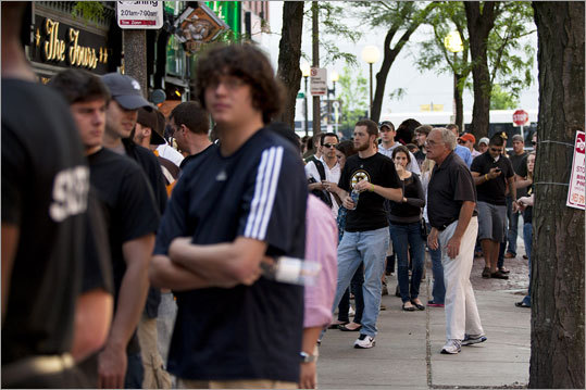 Lines stretched down the length of Canal Street in front of all of the bars near the TD Garden.