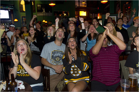 At the Bleacher Bar, Angela Groves of Manchester, N.H., and Alejandro Garbalosa and Kelley Ryan of Brighton (from left) cheered when the Bruins scored their first goal in Game 7 of the Stanley Cup Final.