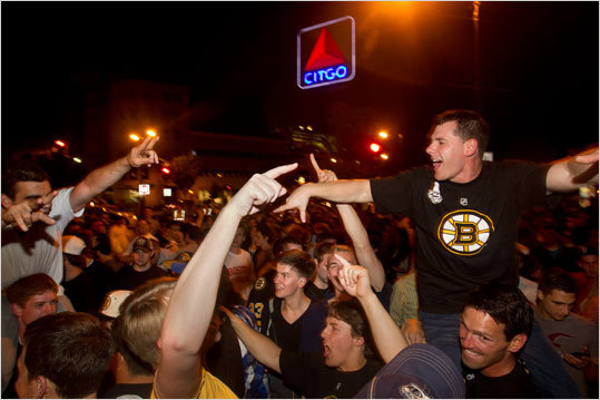 William Crimmins, right, of Canton, Mass., was hoisted on the shoulders of his friends during the post-victory revelry in Kenmore Square.