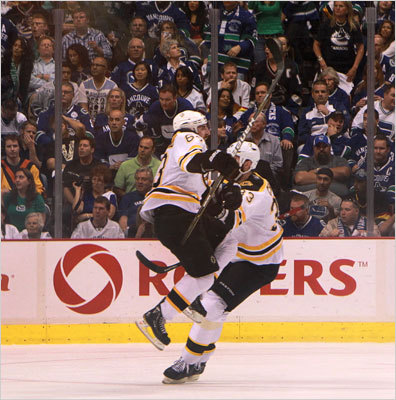 Bruins left wing Brad Marchand leaped into the arms of Boston Bruins defenseman Zdeno Chara after scoring the second goal during the second period.