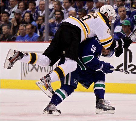 Bruins center Tyler Seguin collided with Canucks right wing Jannik Hansen.