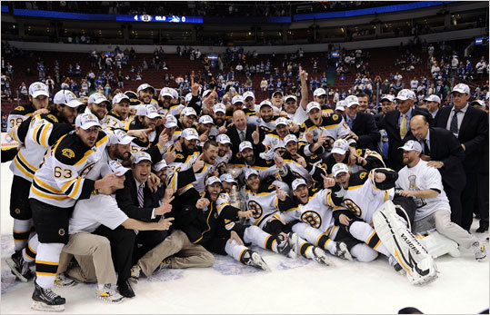 The Bruins posed with the Stanley Cup after defeating the Canucks in Game 7 at Rogers Arena in Vancouver.