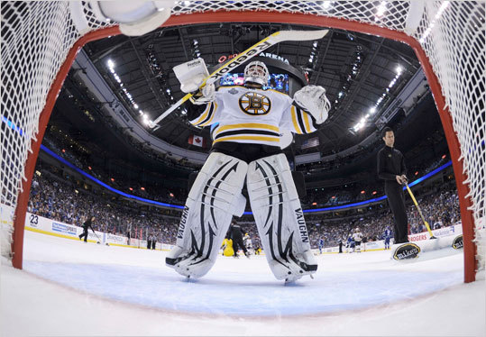 Bruins goalie Tim Thomas skated back to his net after a break in play against the Canucks in the second period.