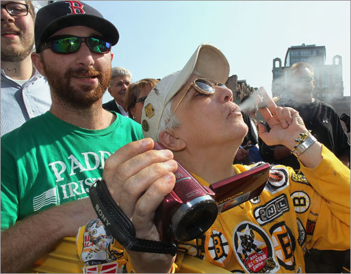 Paula E. Mattaliano of Arlington lit up a victory cigar outside TD Garden.