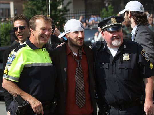 Brad Marchand posed with a couple of Boston police officers.
