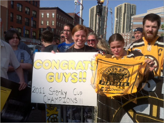 (From left to right) Natalie Lombardi of Dorchester, Shannon Barnes of Lynn, and Michael Fewtrell of Lynn waited to greet the Bruins' return outside of TD Garden Thursday morning.