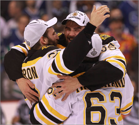 Bruins center Patrice Bergeron (37), left wing Brad Marchand (63), and defenseman Johnny Boychuk (55) celebrated at the end of the game.