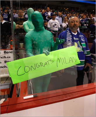 One of the famed Green Men congratulated Bruins left winger Milan Lucic -- a native of Vancouver -- on the Bruins' Stanley Cup win.
