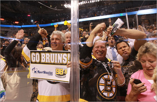 The Bruins fans who traveled to Vancouver and witnessed the game in person at Rogers Arena watched the celebration on the ice.