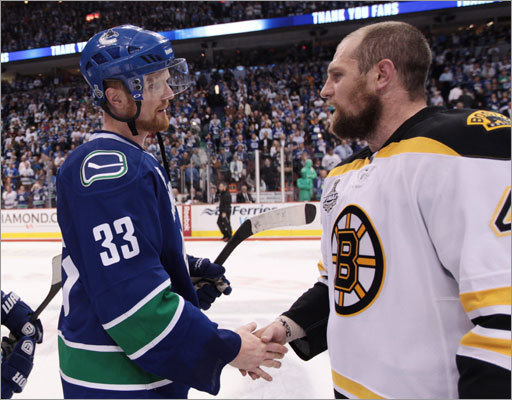 Canucks captain Henrik Sedin (left) shookhands with Dennis Seidenberg following the game.