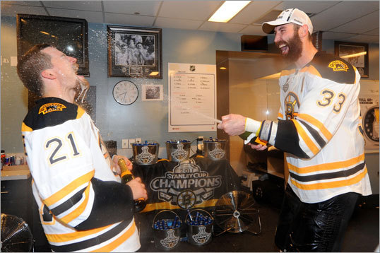 Andrew Ference (left) and Zdeno Chara celebrated with champagne in the Bruins locker room.