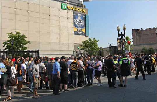 Several hundred fans gathered outside TD Garden to greet the team upon their return to Boston.