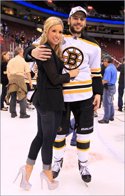 Milan Lucic stood on the ice with his girlfriend following the Bruins' win.